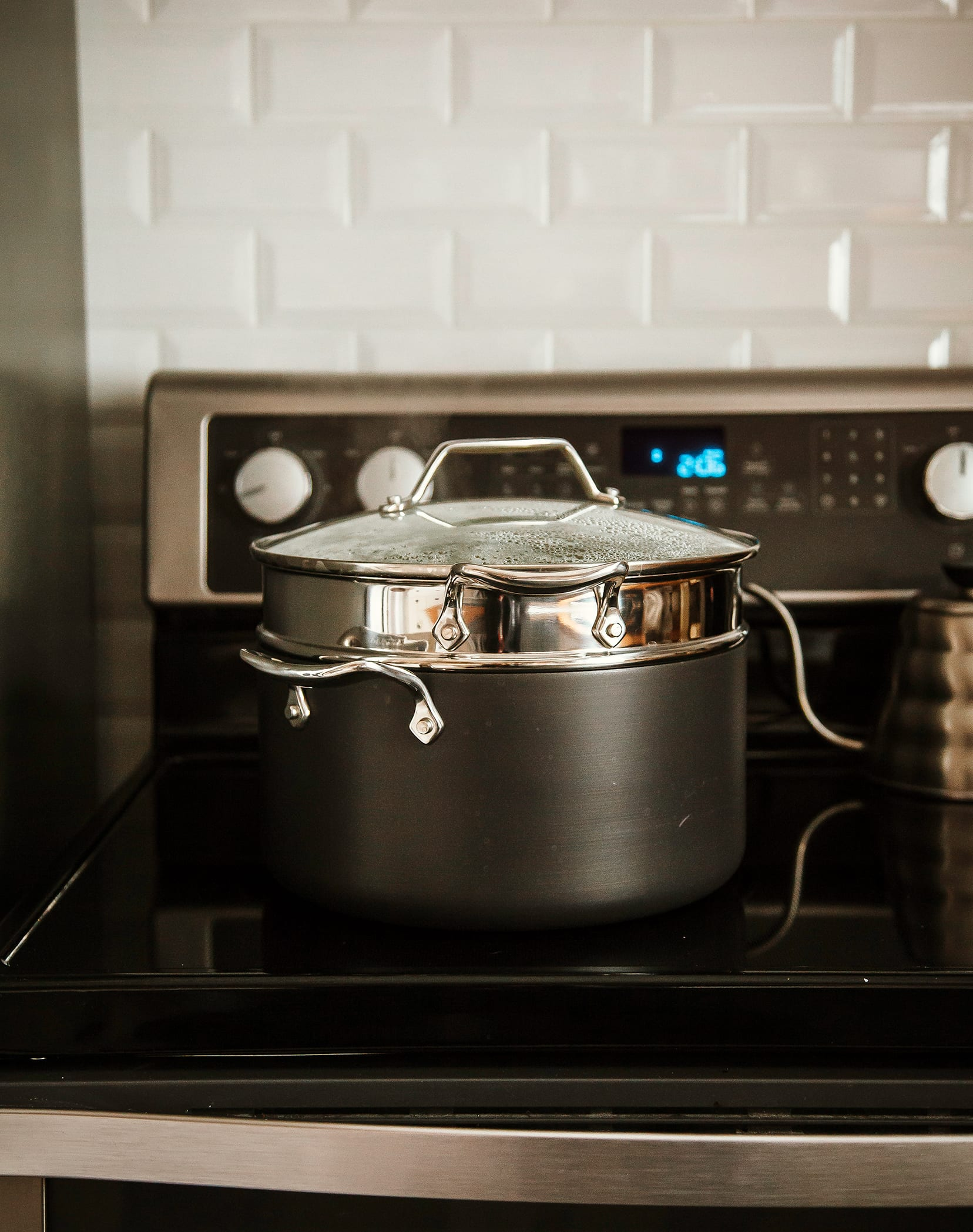 Image shows a double boiler pot on the stove.