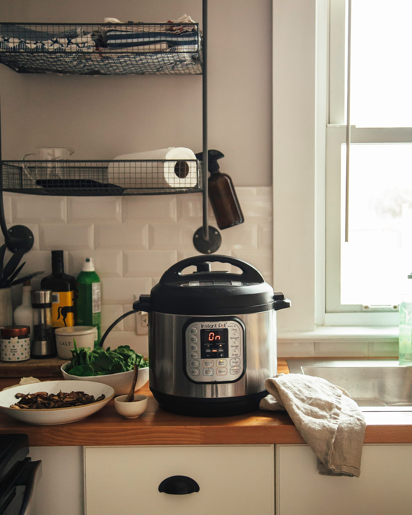 Image shows a kitchen scene with an Instant Pot on the counter.