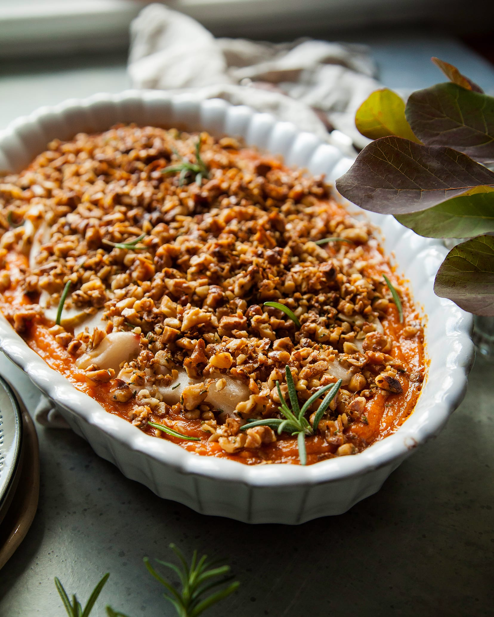 Vegan sweet potato casserole with apples and crunchy rosemary walnuts