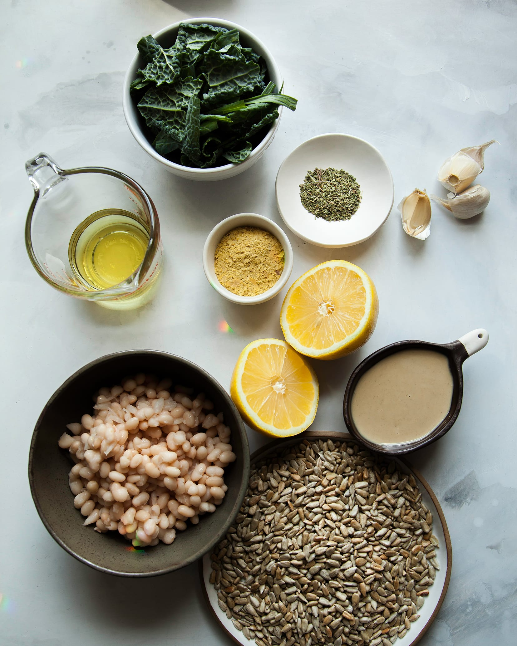 Overhead image of ingredients used for a creamy kale pesto dip.