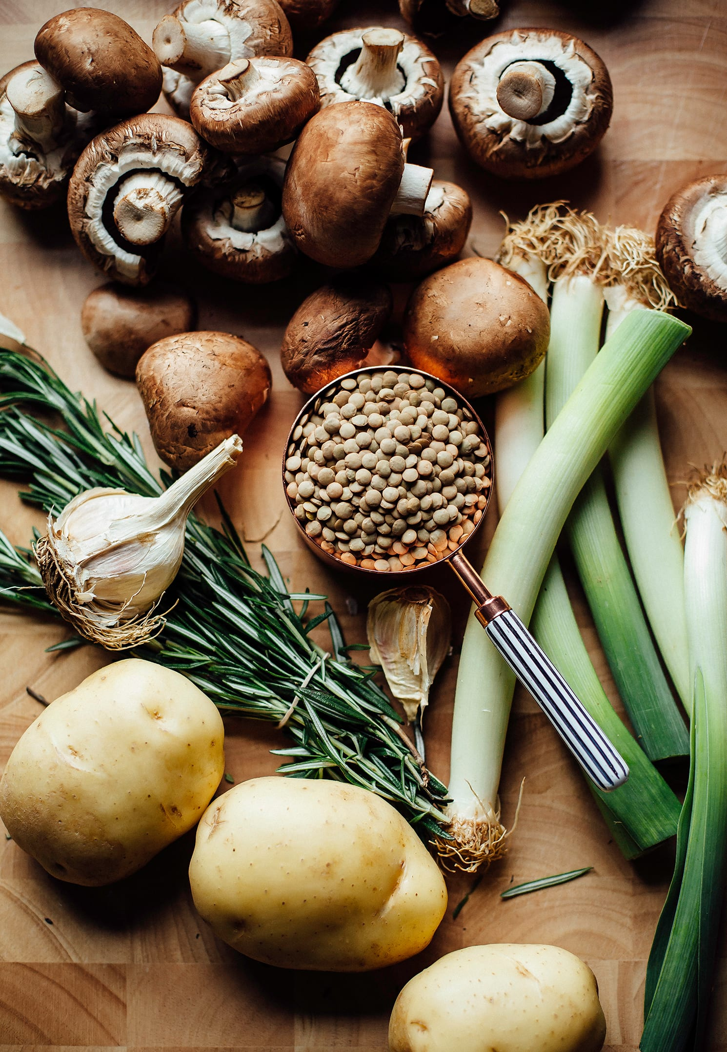 An overhead shot of ingredients for a lentil stew.