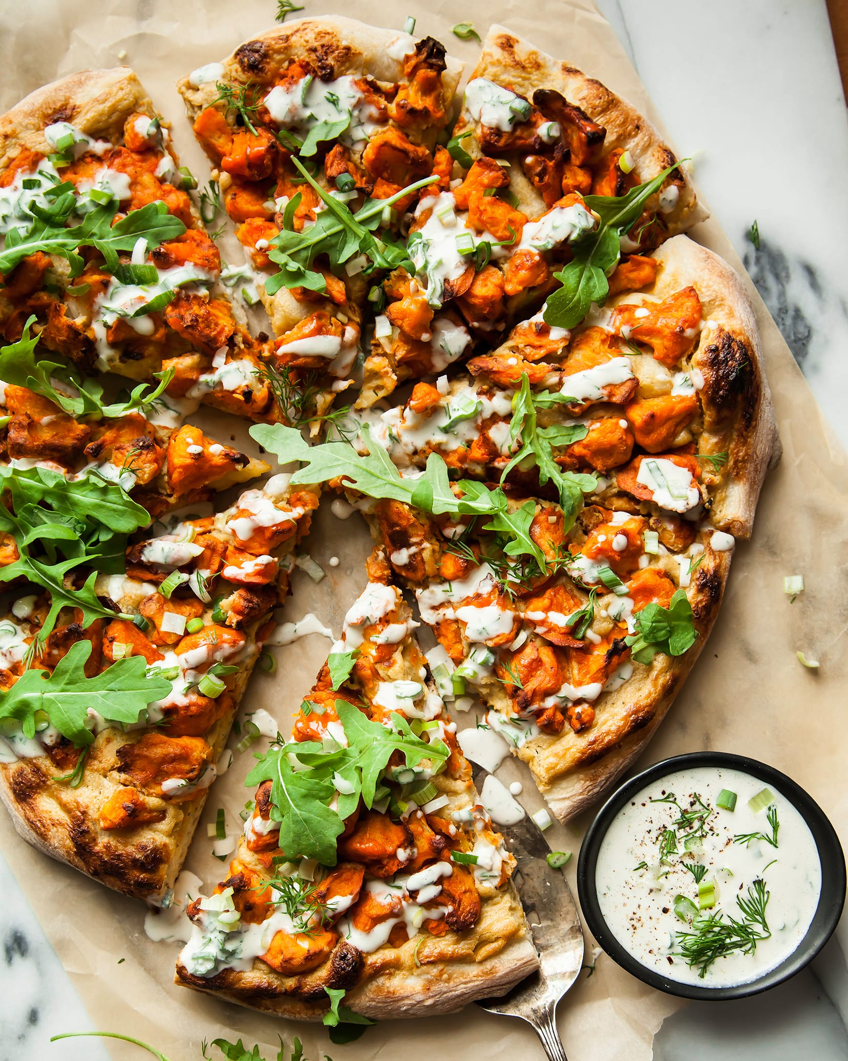 VEGAN BUFFALO CAULIFLOWER PIZZA W/ ONION CREAM - The First Mess