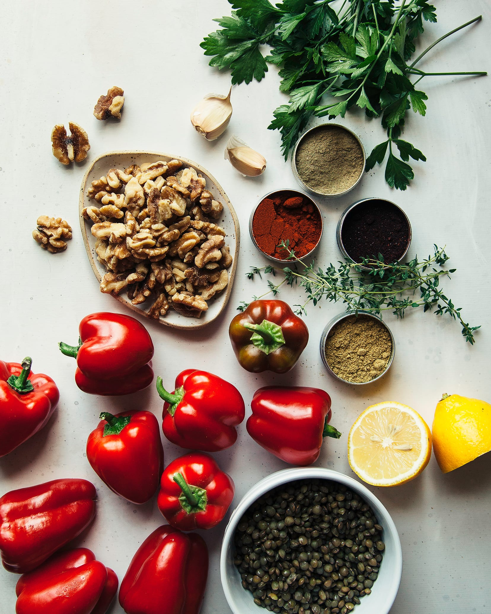 An overhead shot of ingredients for stuffed grilled mini peppers with lentil and walnut crumble.