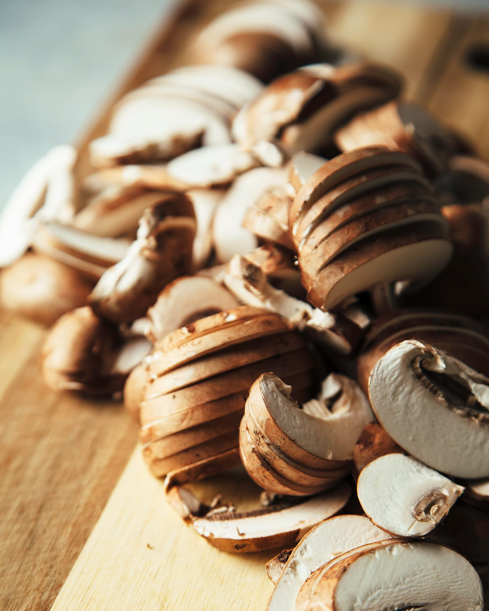 A 3/4 angle shot of some sliced mushrooms.