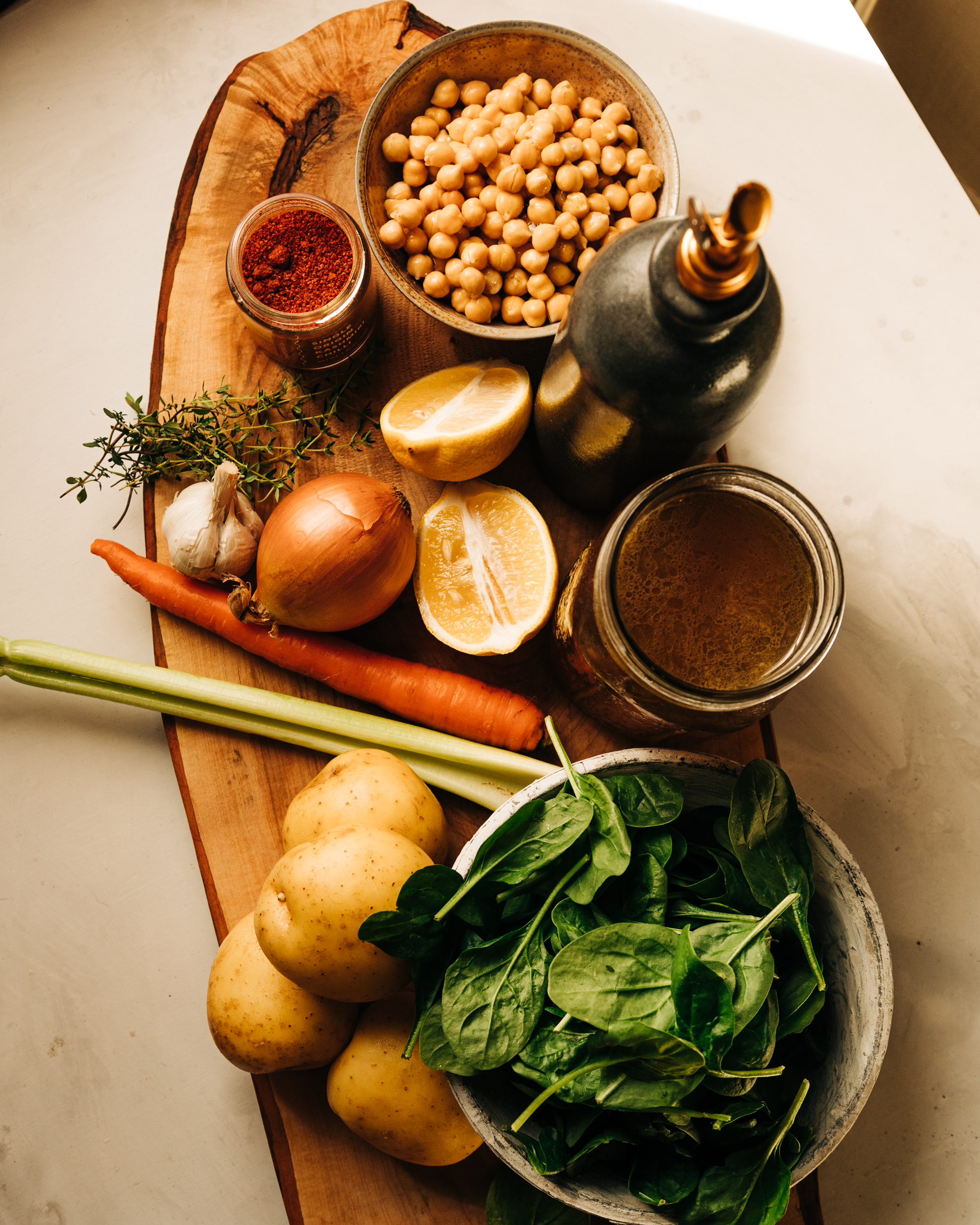 An overhead shot of ingredients on a wooden board.
