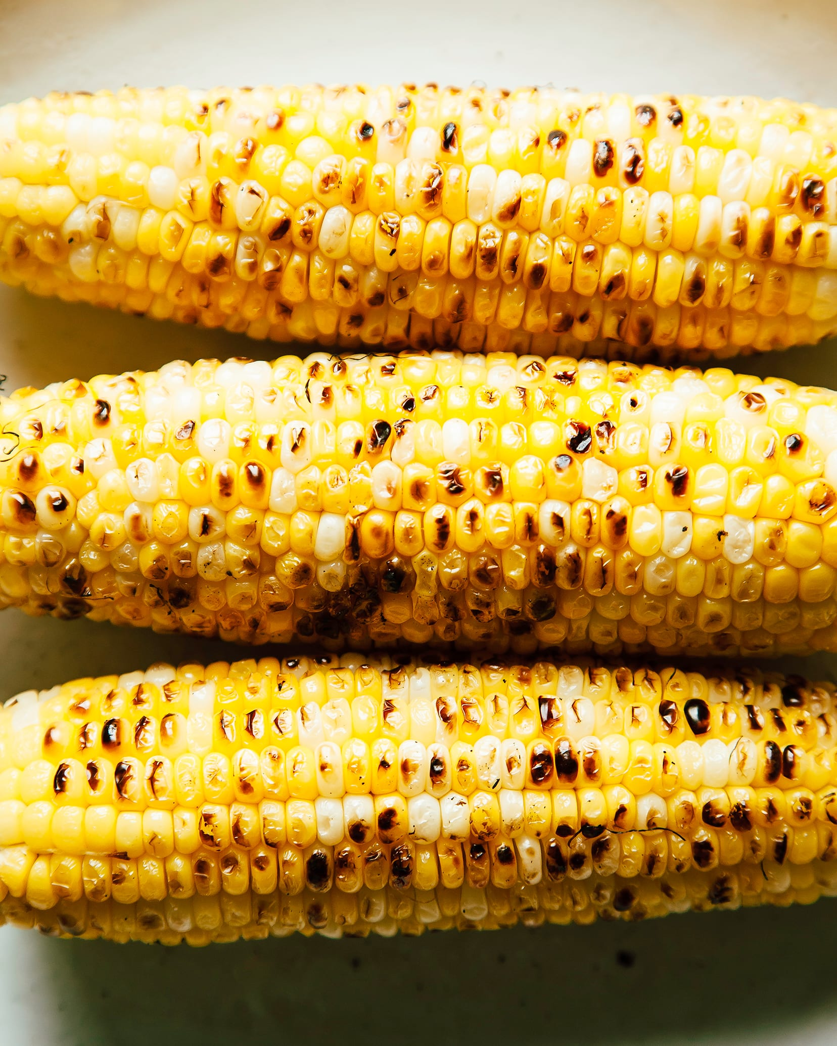An up close, overhead shot of charred corn cobs.