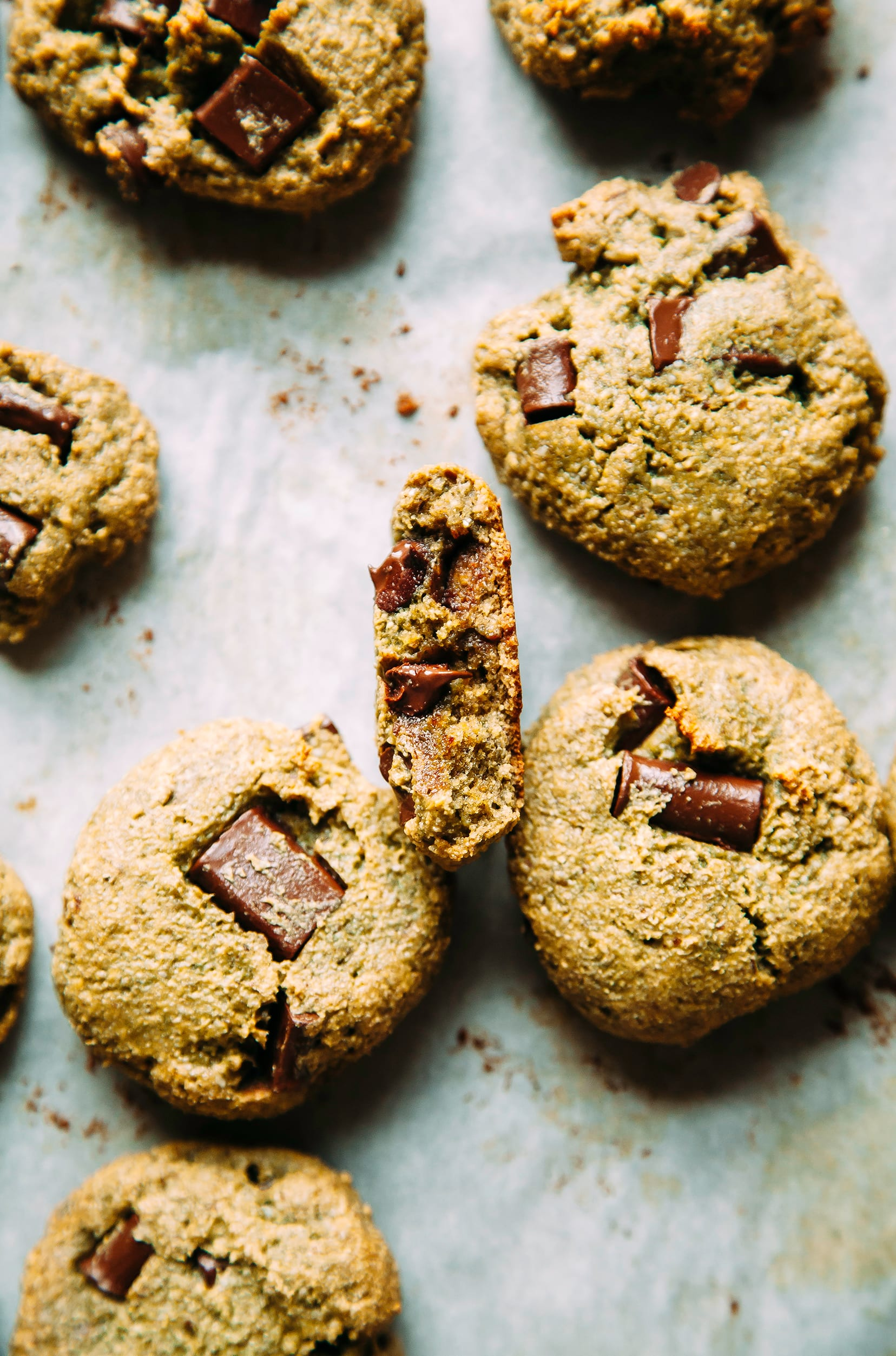 An overhead shot of chocolate chip wonder cookies on a white parchment paper background.