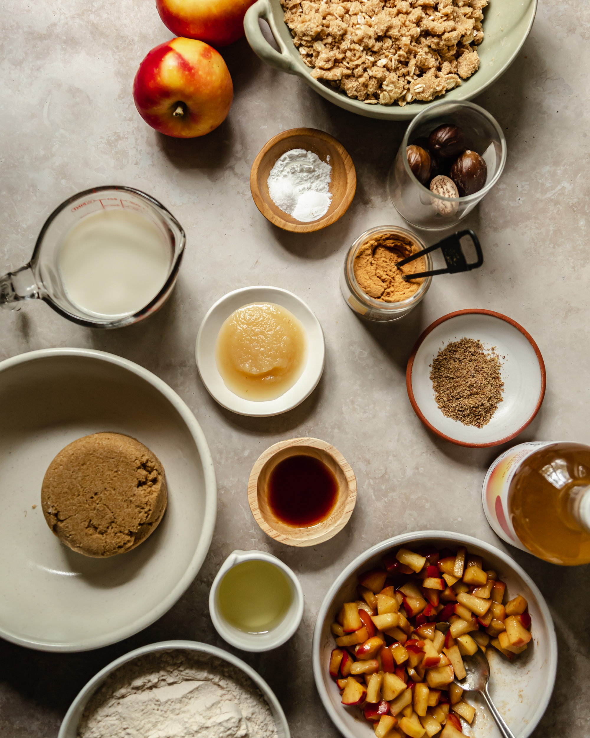 An overhead shot of ingredients for vegan apple crips muffins.