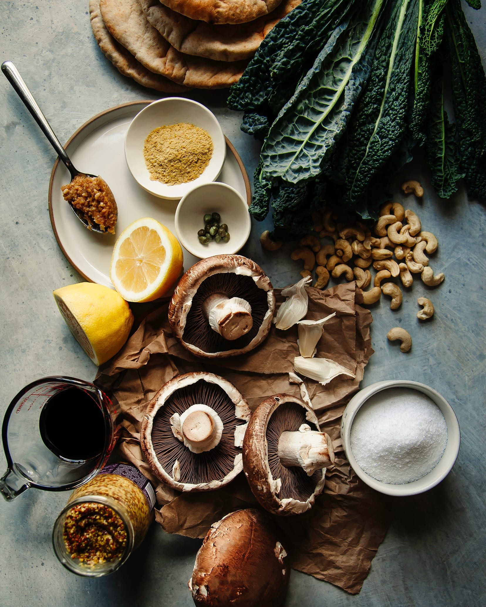 An overhead shot of ingredients for making a grilled mushroom pita with greens.
