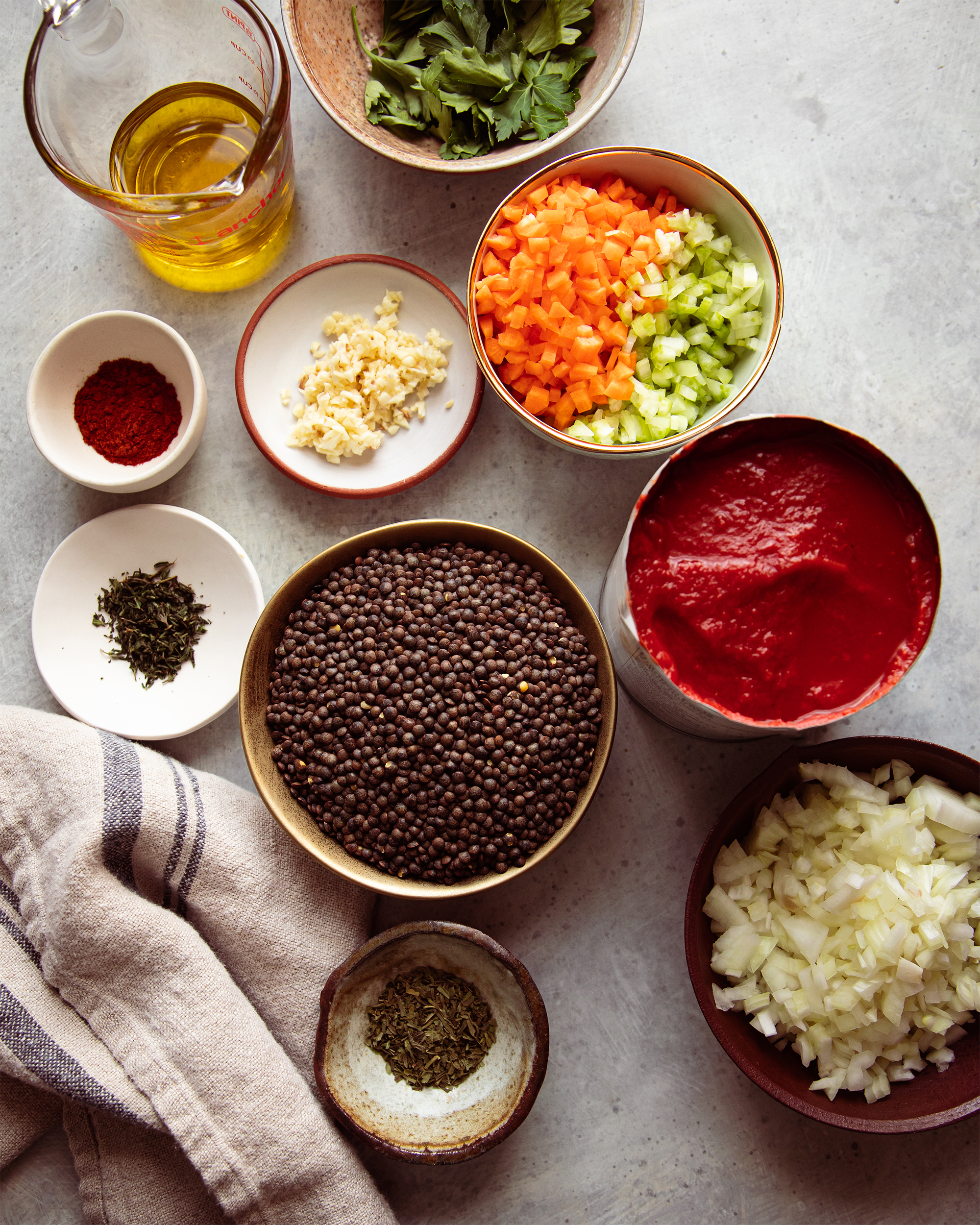 Image taken from overhead displays prepped ingredients for a lentil soup.