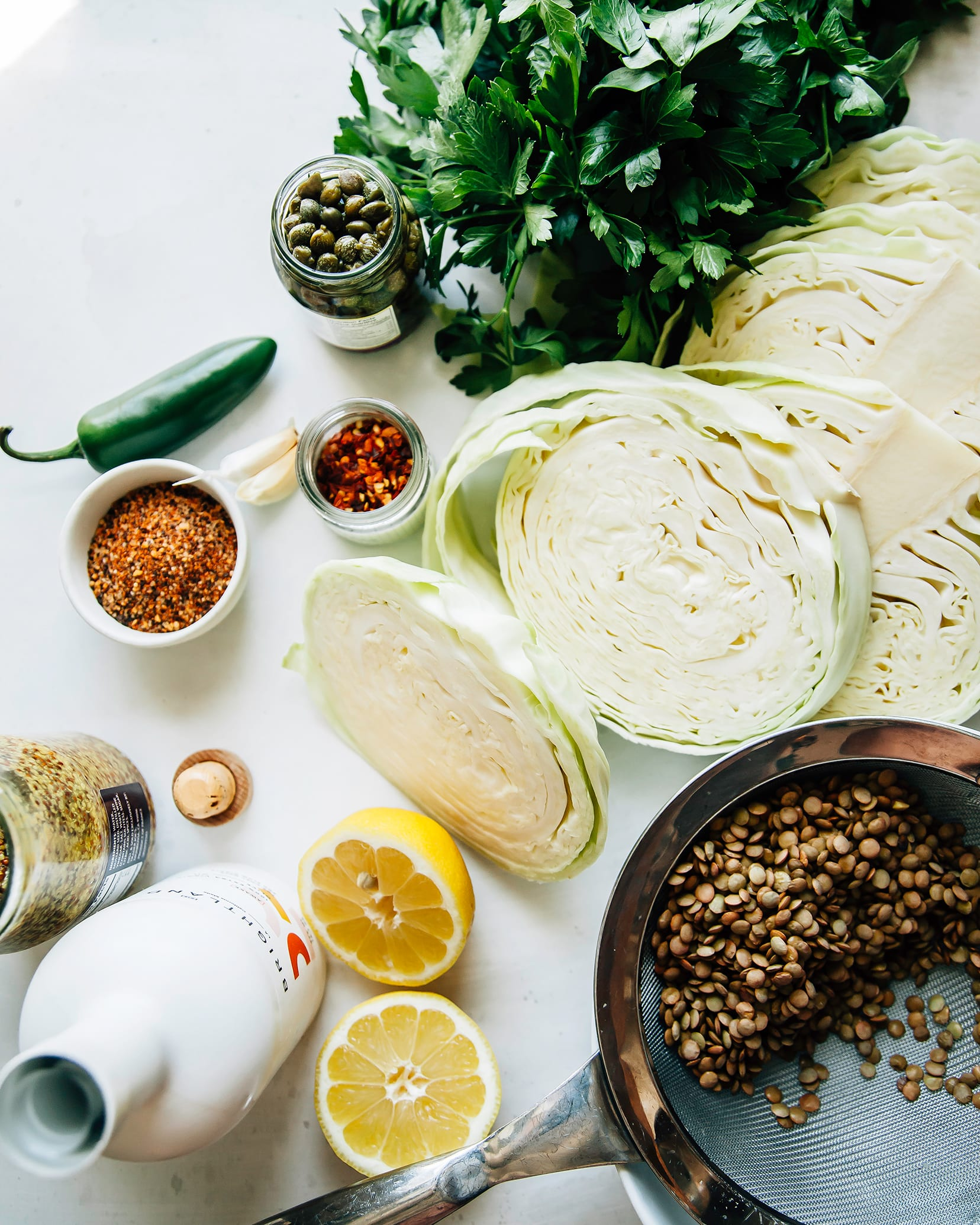 Image taken from overhead shows ingredients for a grilled cabbage dish.