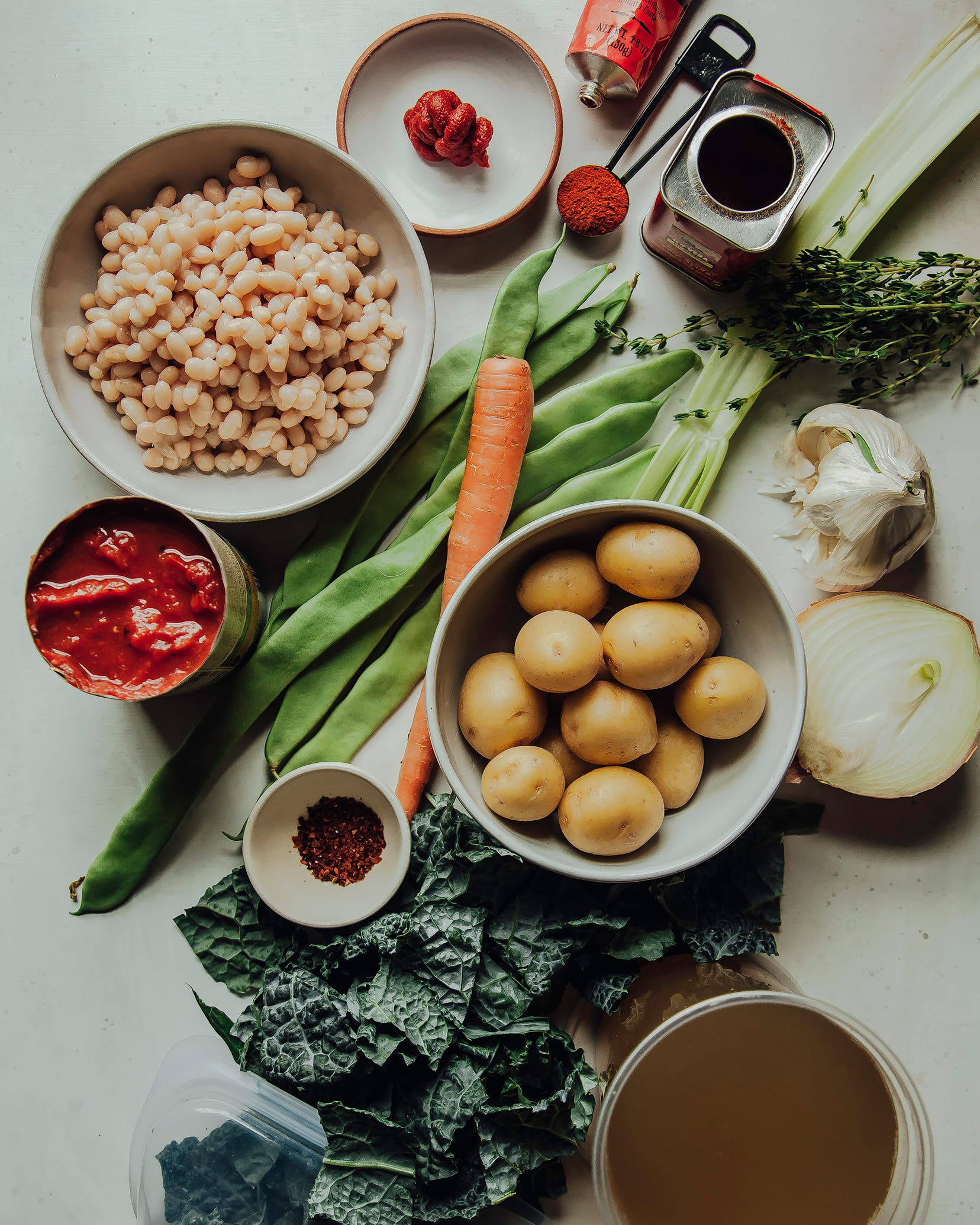 An overhead shot of ingredients for a white bean stew.
