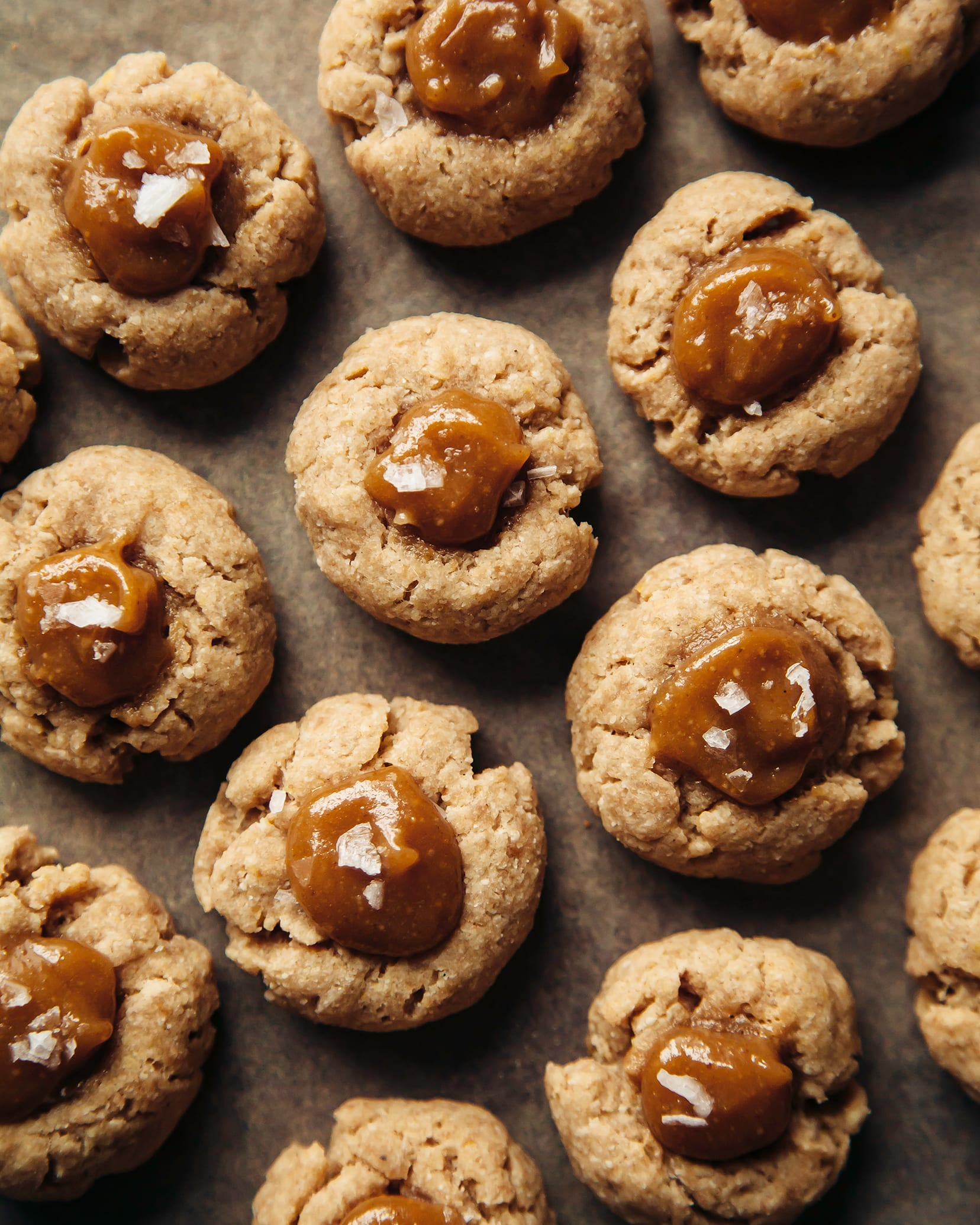 Overhead shot of cardamom thumbprint cookies with peanut butter caramel centers.