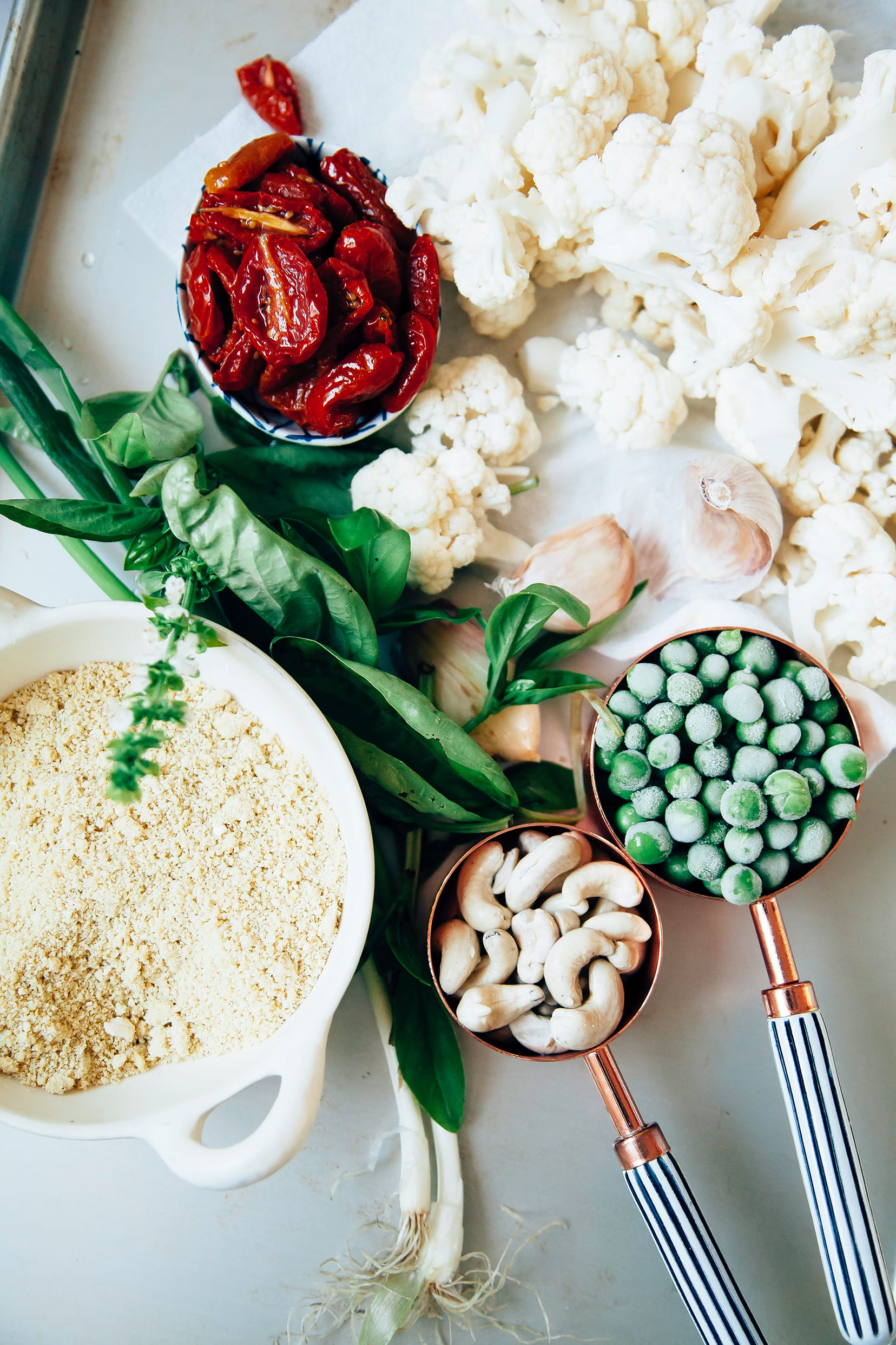 An overhead shot of ingredients for a creamy cauliflower pasta.