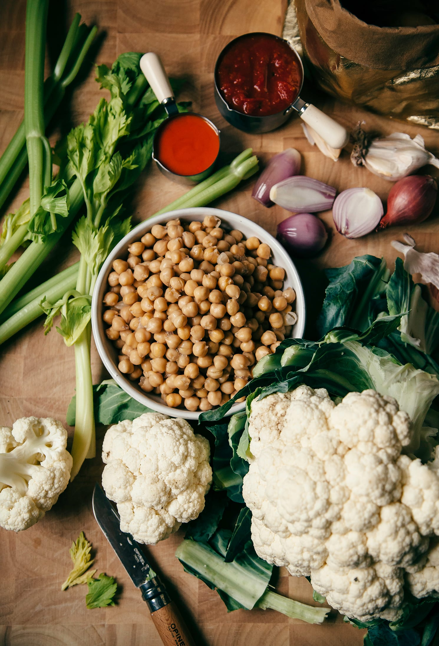 Overhead shot of ingredients for chickpea and cauliflower-stuffed baked potatoes.