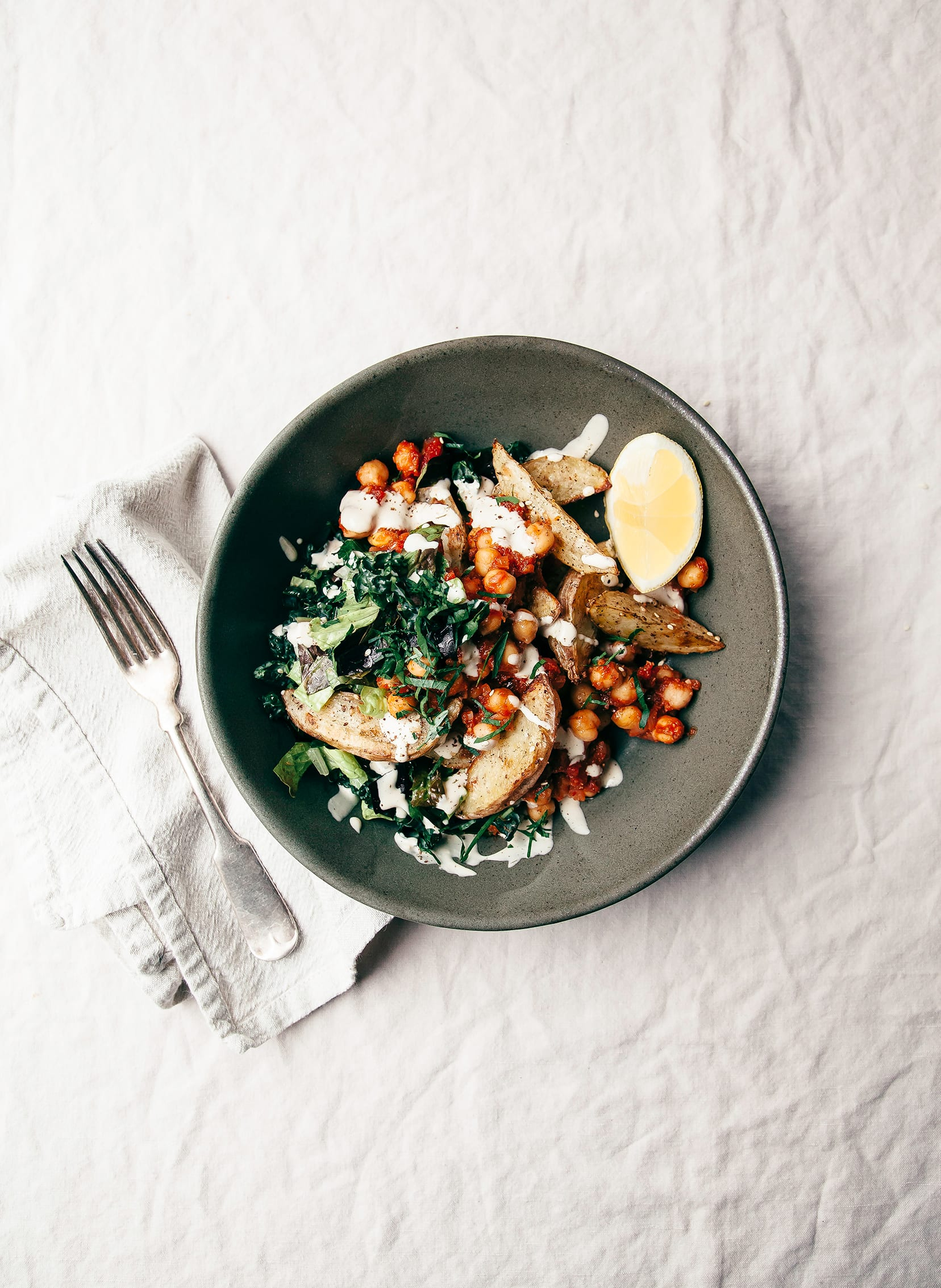 Harissa Chickpea Bowl with Potatoes, Lemon-y Tahini & Greens - The First Mess
