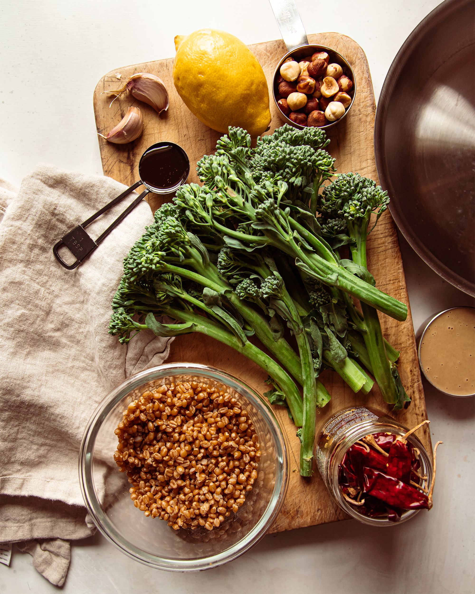 An overhead shot of ingredients for a vegetable dish.