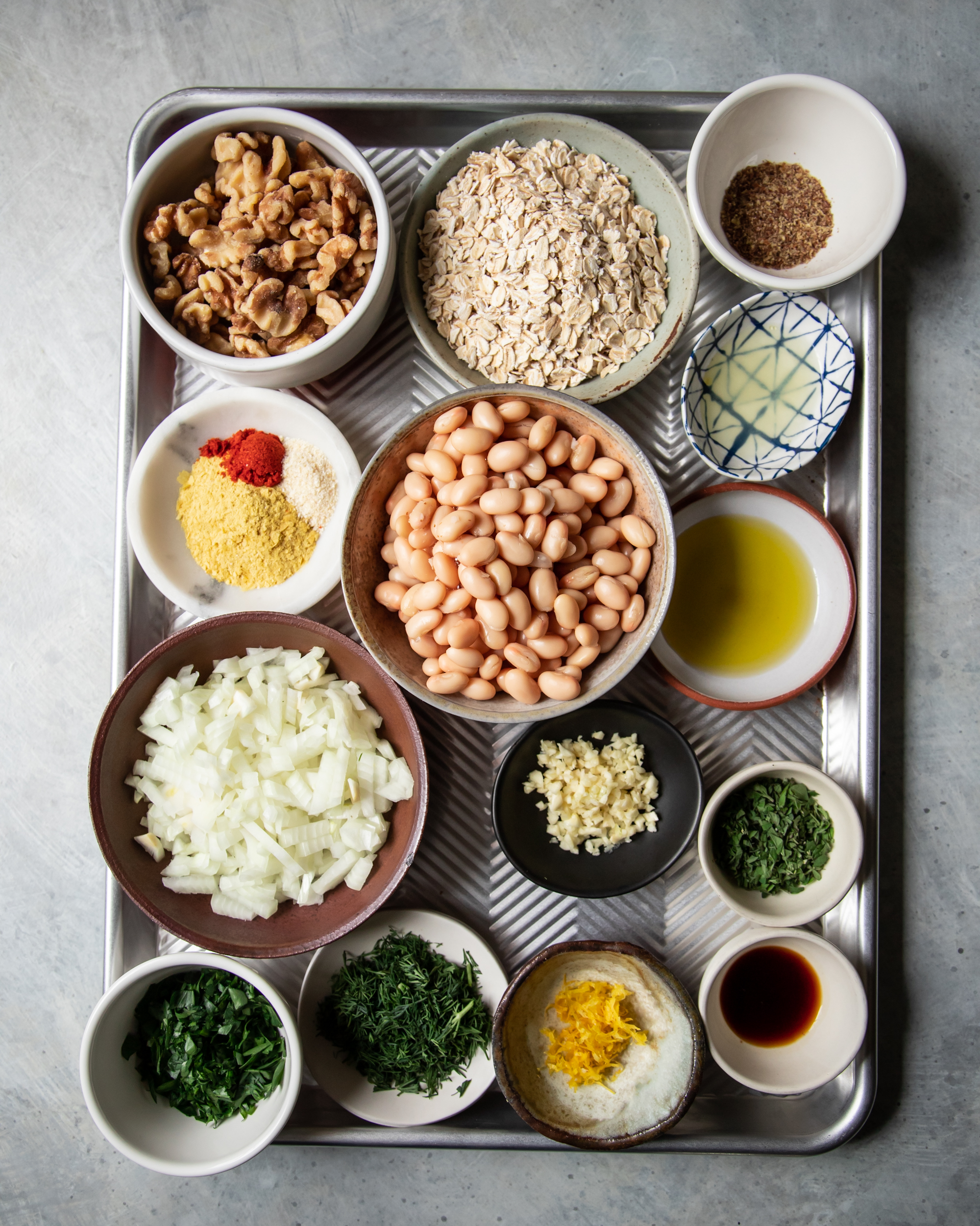 An overhead shot of prepped and measured ingredients on a baking sheet.