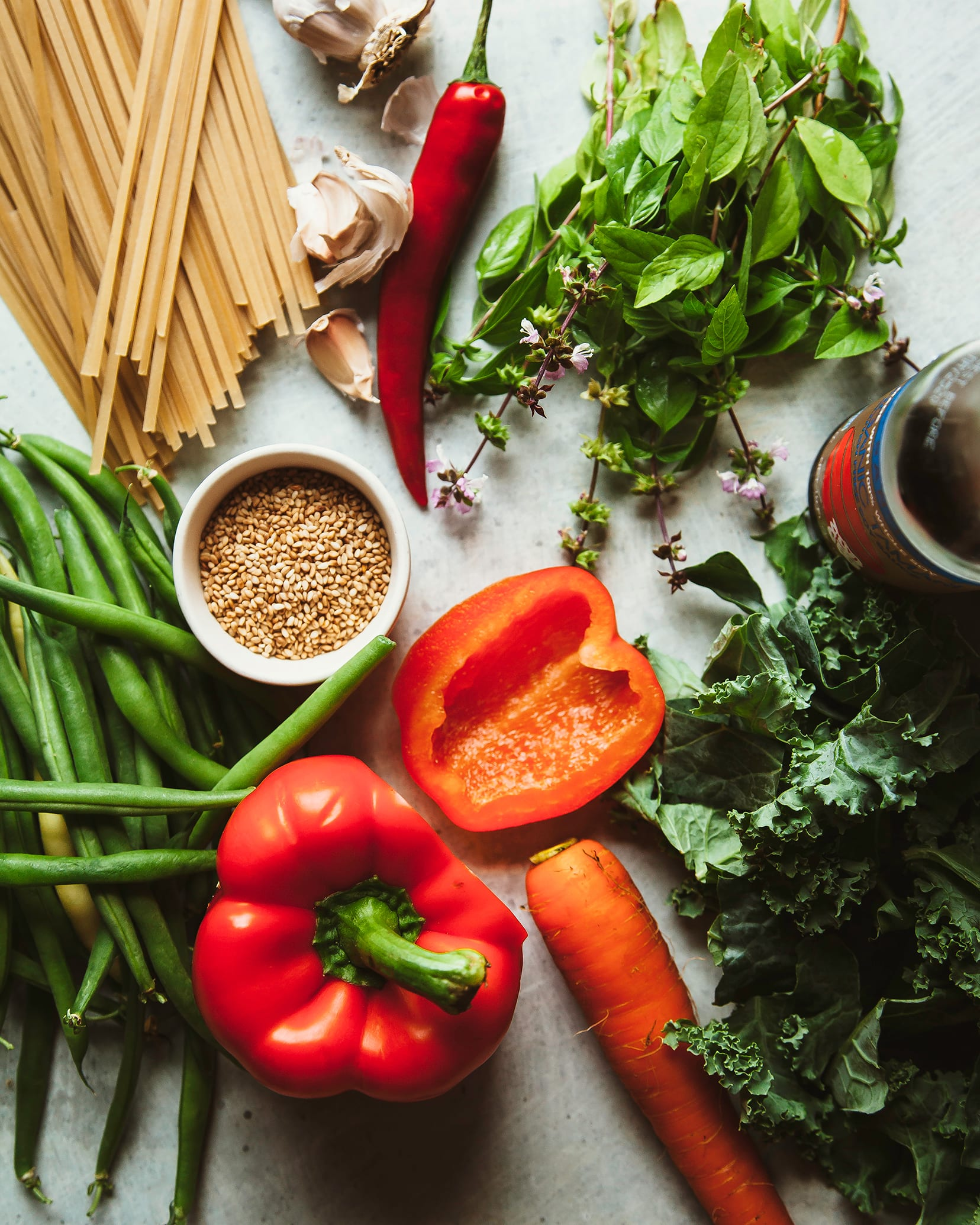 An overhead shot of ingredients for a vegan Thai basil noodle dish.