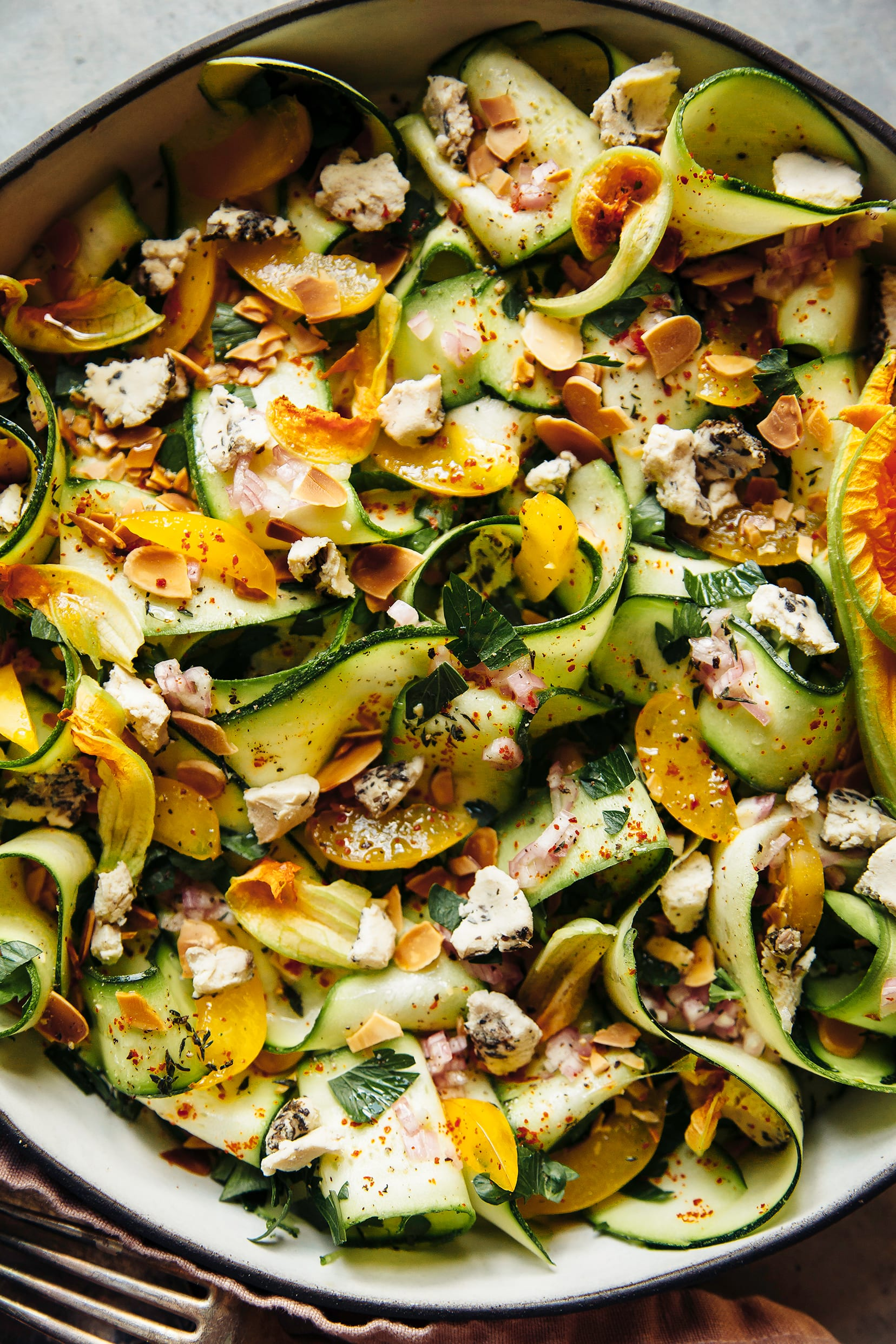 Shaved zucchini salad with plums, herbs and almonds.