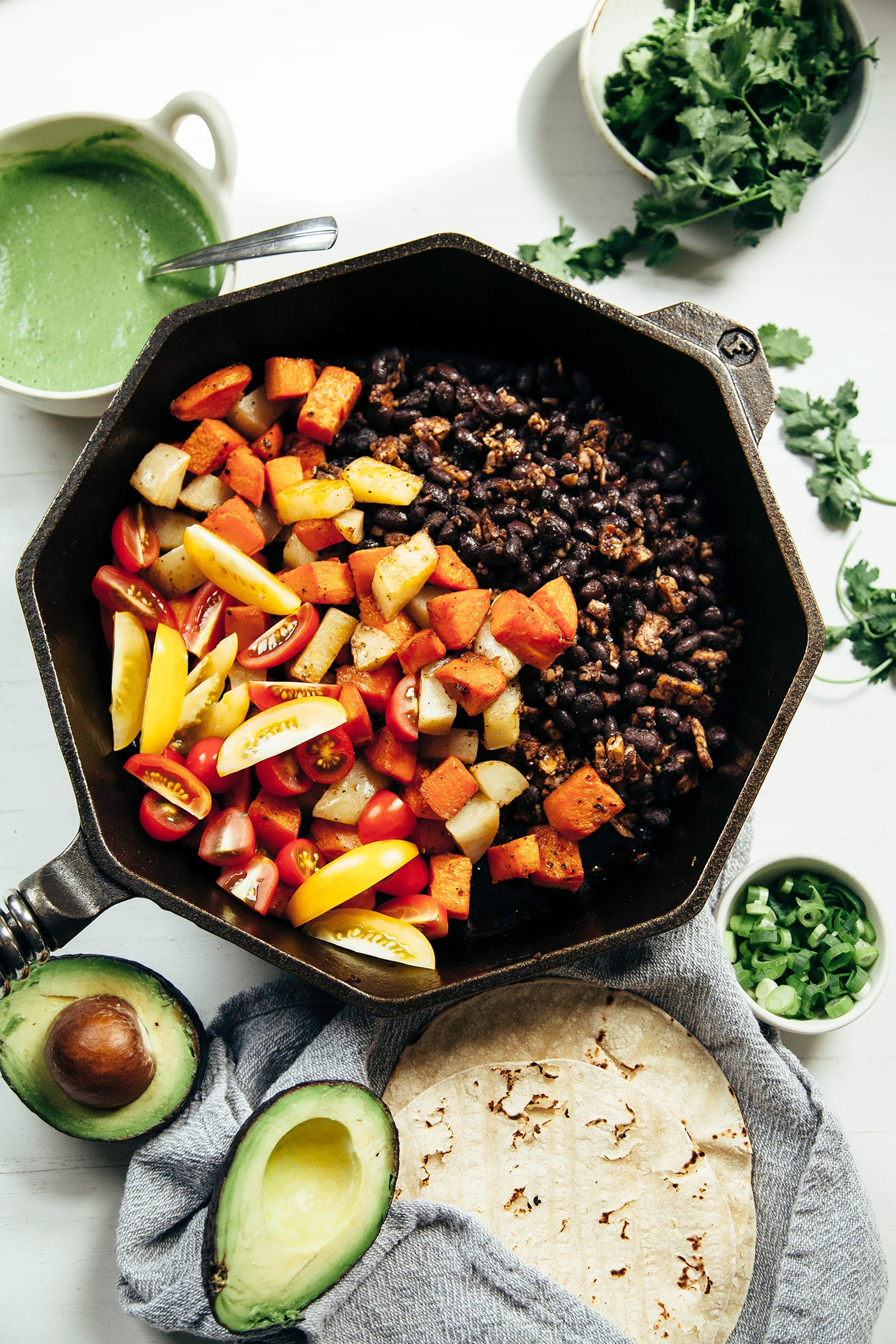 cozy & spicy vegan breakfast skillet w/ cilantro jalapeño sauce - The First Mess