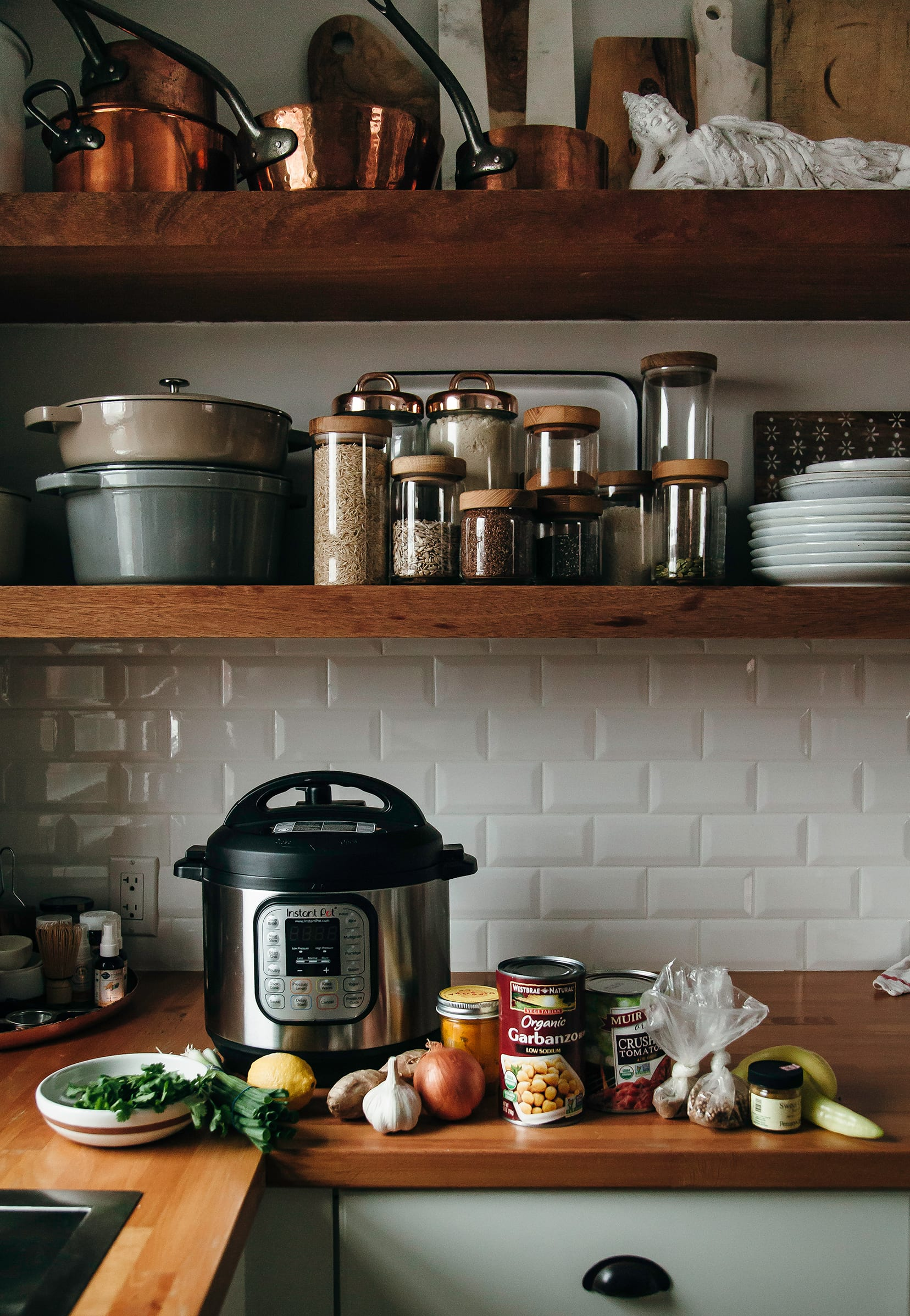 Image shows a kitchen scene with soup ingredients on the counter along with an Instant pot.