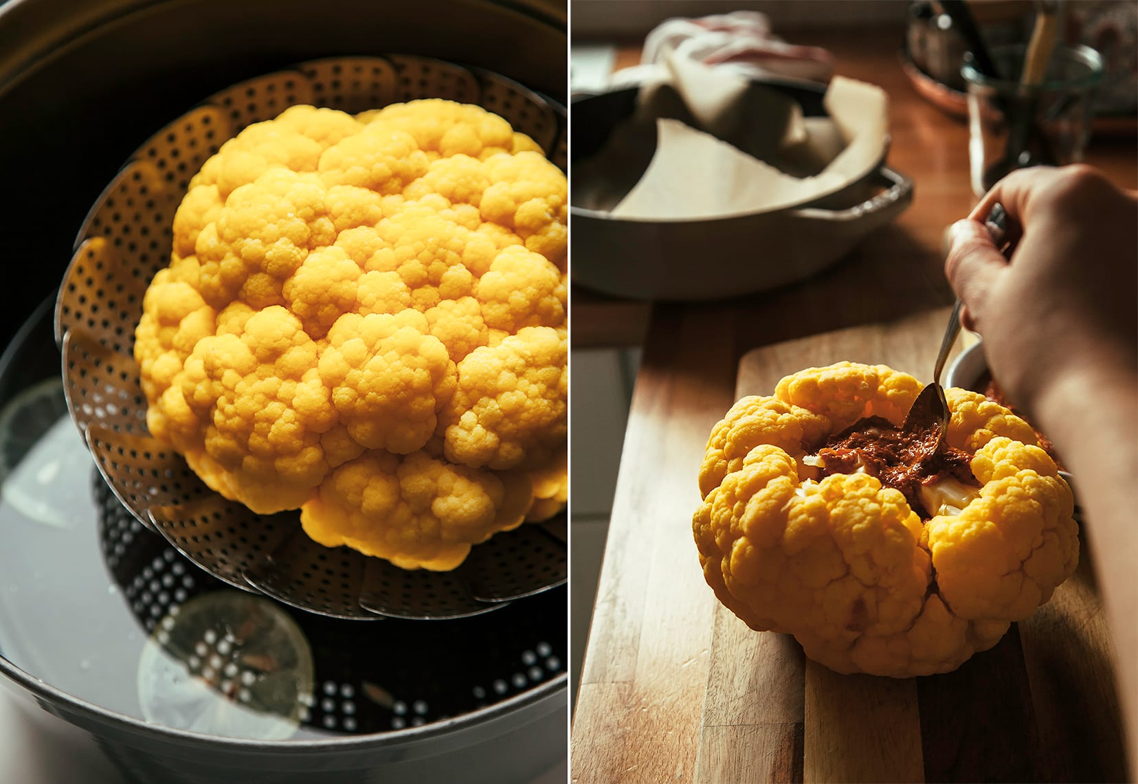 Image shows a whole steamed cauliflower as well as a hand spooning romesco into the core of the cauliflower.
