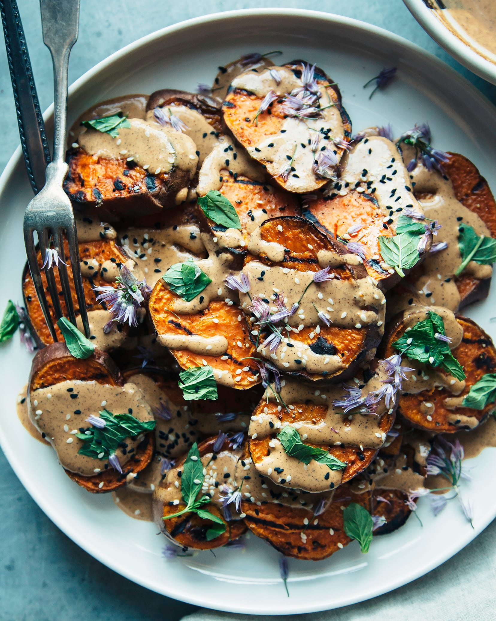 Overhead shot of grilled sweet potatoes with Chile lime tahini sauce.