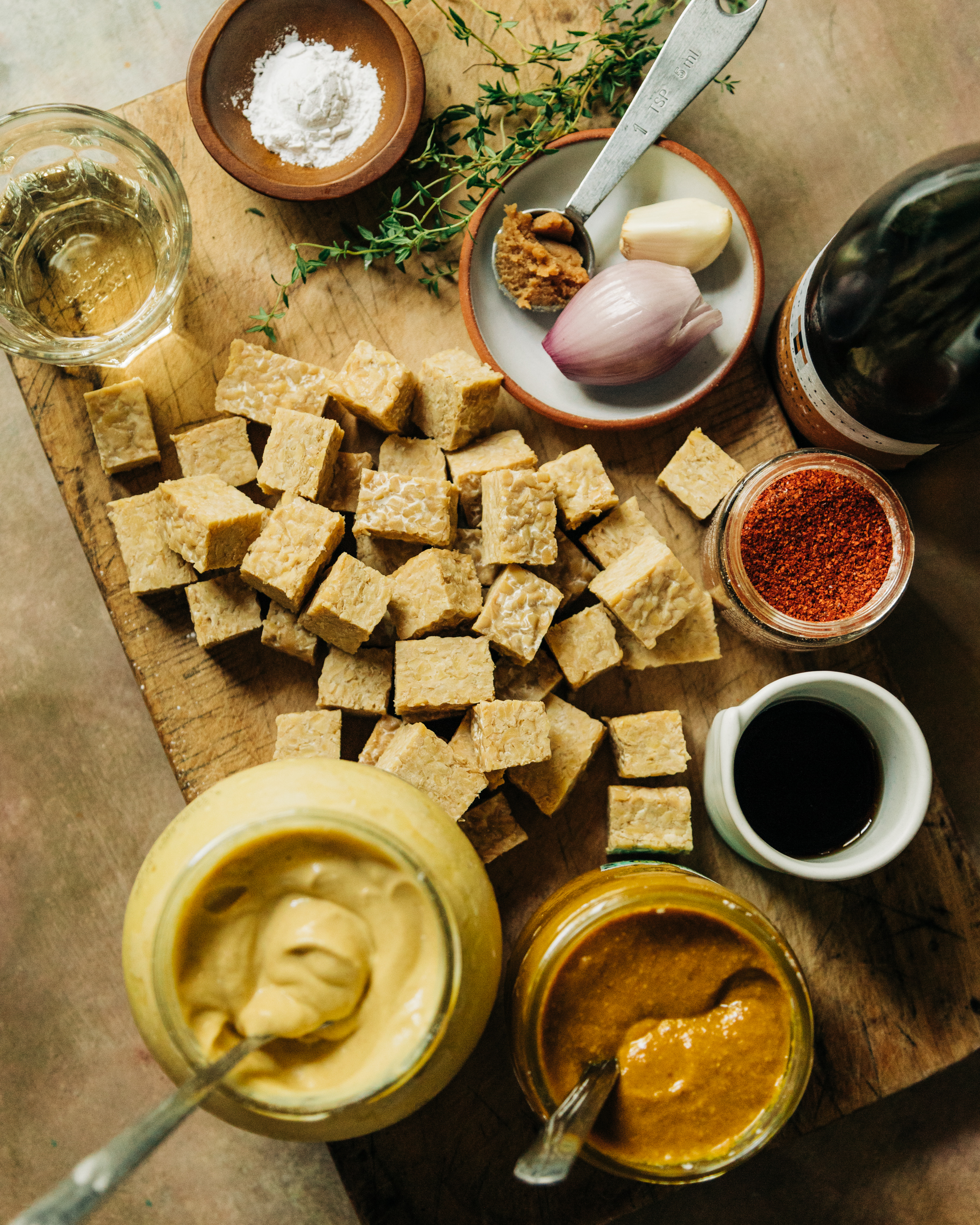 An overhead shot of ingredients used to make a saucy g;azed tempeh recipe.