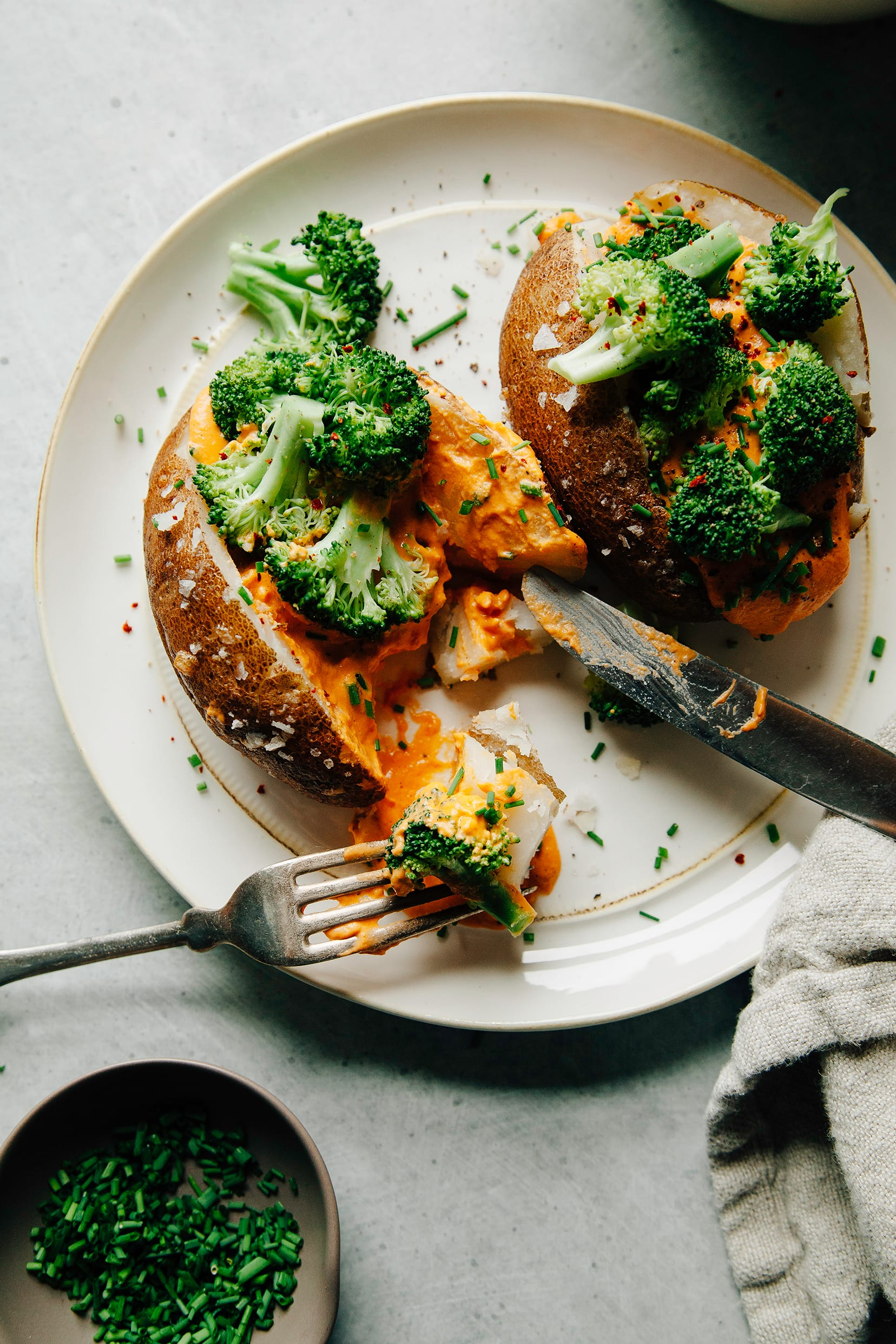 SALT-BAKED POTATOES WITH CHEESY ROASTED RED PEPPER SAUCE & BROCCOLI (vegan, nut-free) - The First Mess