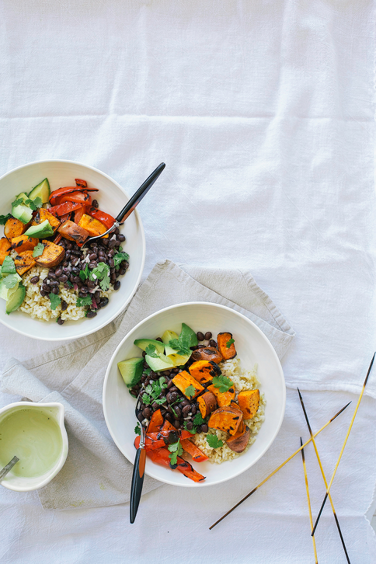 simple sweet potato + black bean burrito bowls with cumin garlic drizzle // @thefirstmess