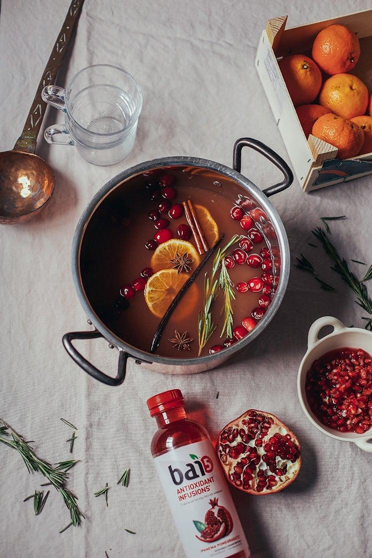 Mulled pomegranate cider with vanilla + rosemary via thefirstmess.com