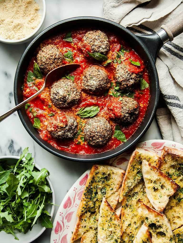 GIANT VEGAN MUSHROOM MEATBALLS & GARLIC BREAD - The First Mess #veganrecipes #healthyrecipes