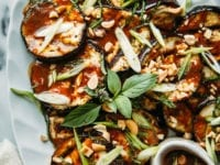 Image shows finished plating of a grilled eggplant dish with peanut butter teriyaki sauce.
