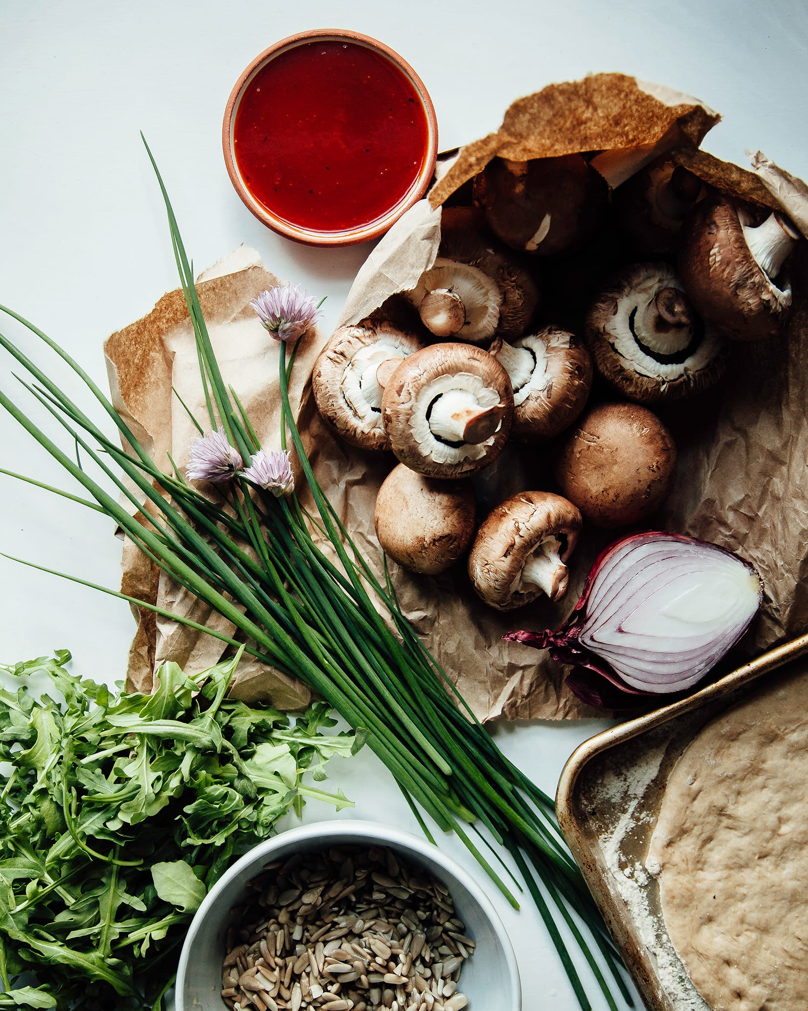 Overhead shot of all ingredients for a BBQ mushroom flatbread.