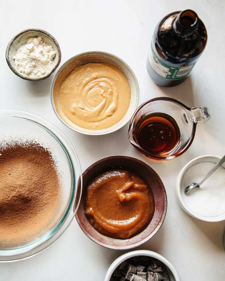An overhead shot of the ingredients used to bake brownies, all in individual decorative bowls.