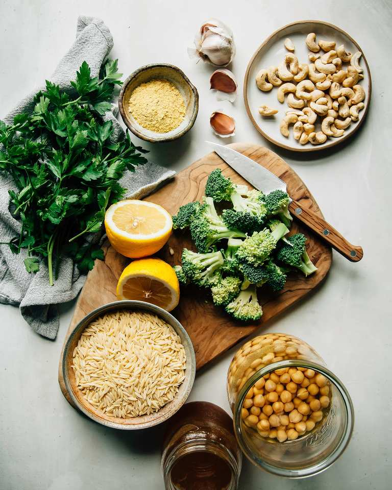 An overhead shot of ingredients for creamy lemon orzo with chickpeas and broccoli